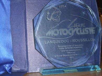 Un trophée à notre logo de la part des bikers catalans